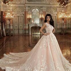 93bb5e642 محلات ومتاجر فساتين الزفاف والخطوبة في أبوظبي | Zafaf.net